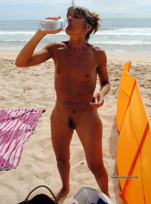 Bare middle-aged dame on the nudists beach