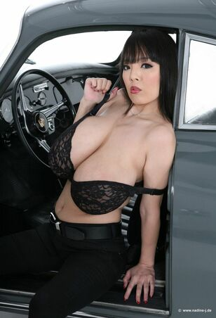 Asian  Hitomi Tanaka showing her gigantic milk cans with..