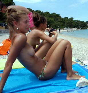 Nubile nymph cameraman  on the beach