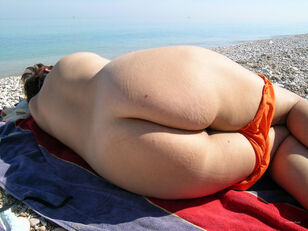 Mature wife on beach yam-sized bra-stuffers suspending..