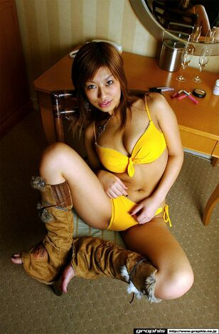 Big-titted asian model Yukari Fujikawa posing in yellow..