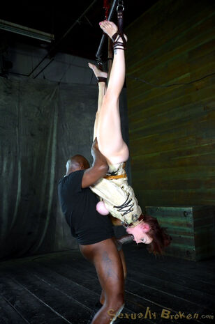 Bella Rossi is corded down and dangled in a  of  confine..
