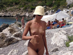 Totally bare Crimean stunner on the beach at nude-in-russia